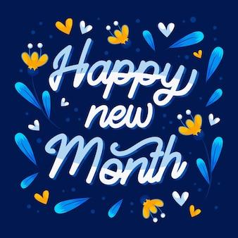 Szczęśliwego nowego miesiąca napis z różnymi elementami