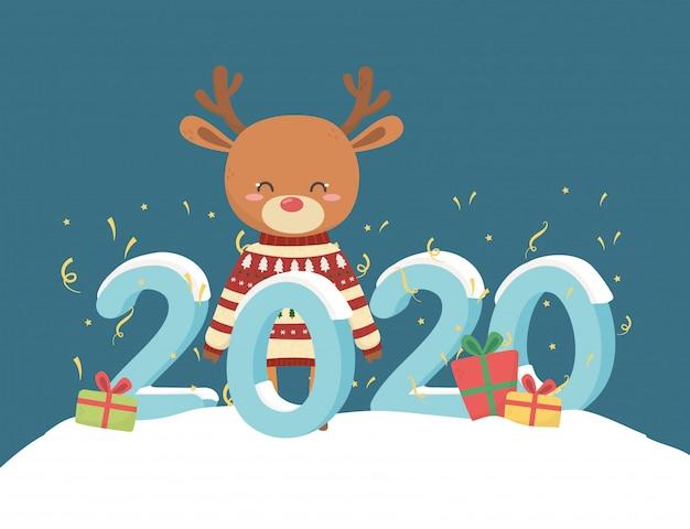 Szczęśliwego nowego roku 2020 obchodzi renifer z brzydkim swetrem prezenty śniegu