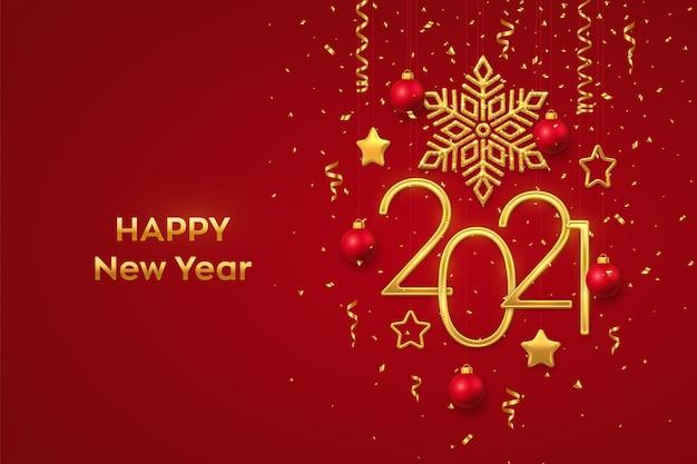Szczęśliwego nowego roku 2021. wiszące złote metaliczne cyfry 2021 z błyszczącym płatkiem śniegu
