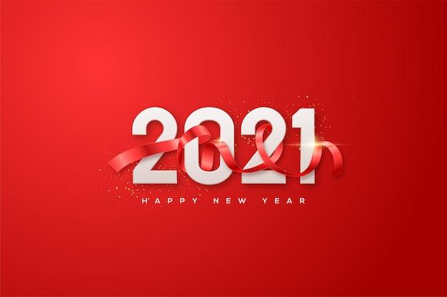 Szczęśliwego nowego roku 2021 z białymi cyframi i czerwoną wstążką zakrywającą liczby.