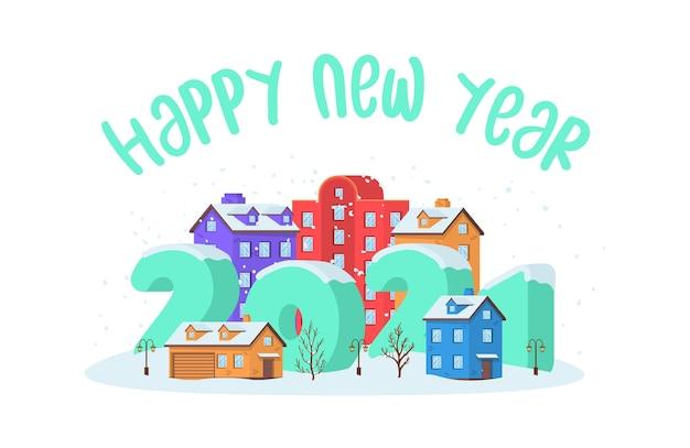 Szczęśliwego nowego roku 2021 z zimowym krajobrazem w mieście w wigilię bożego narodzenia.