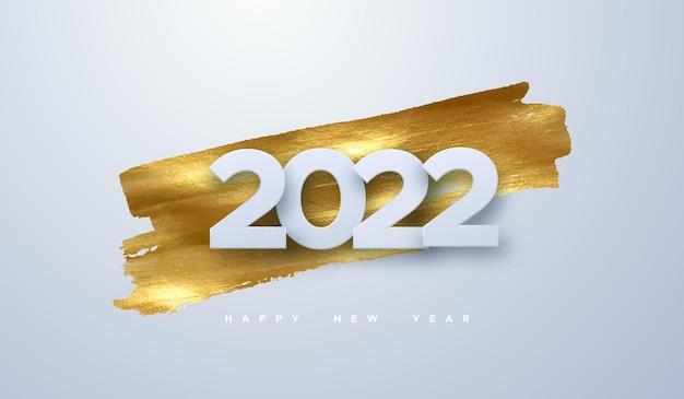 Szczęśliwego nowego roku 2022 biały znak papieru na złotym tle plamy farby