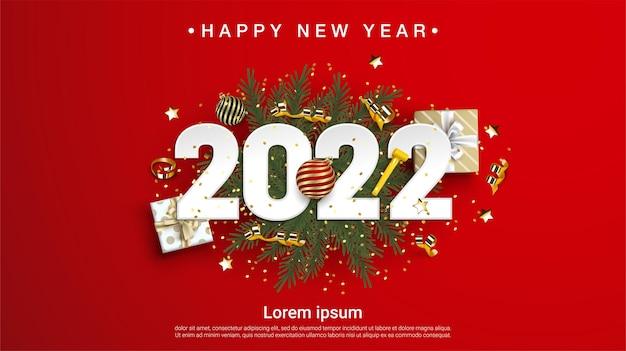 Szczęśliwego nowego roku 2022 numery na zielonych gałęziach jodły na czerwonym tle