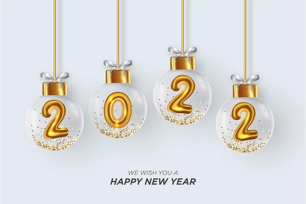 Szczęśliwego nowego roku 2022 tło z realistyczną bożonarodzeniową kulą 3d