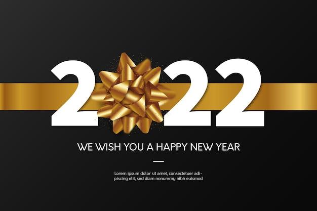 Szczęśliwego nowego roku 2022 tło ze złotą wstążką