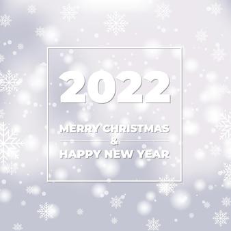 Szczęśliwego nowego roku białe tło bokeh z płatkami śniegu