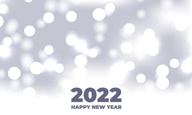 Szczęśliwego nowego roku biały bokeh świąteczny efekt rozmytego światła