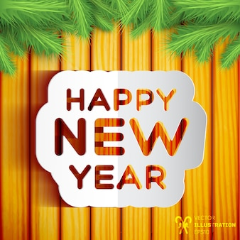 Szczęśliwego nowego roku karty na drewnianej ścianie ozdobionej gałęziami jodły