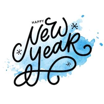 Szczęśliwego nowego roku odręcznie napis nowoczesny pędzel z niebieskim rozchlapaniem akwarela