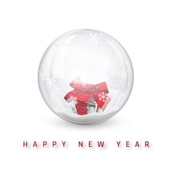 Szczęśliwego nowego roku z kulą śnieżną kulę ziemską z pudełkiem.