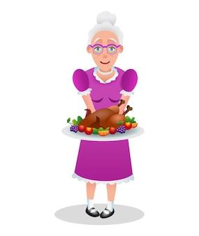 Szczęśliwego święta dziękczynienia. postać z kreskówki babcia trzyma pieczonego indyka. babcia ze świątecznym obiadem