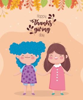 Szczęśliwego święta dziękczynienia słodkie dziewczynki, trzymając się za ręce liści