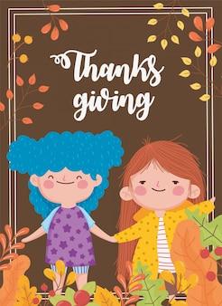 Szczęśliwego święta dziękczynienia słodkie dziewczyny trzymając się za ręce spadają liście