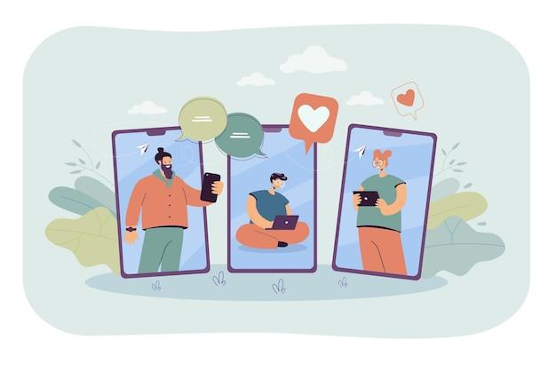 Szczęśliwi ludzie na ekranach telefonów komórkowych komunikują się online. mężczyzna z laptopem, dziewczyna z płaską ilustracją tabletu