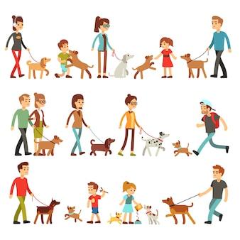 Szczęśliwi ludzie ze zwierzętami. kobiety, mężczyźni i dzieci bawiące się z psami i szczeniętami.