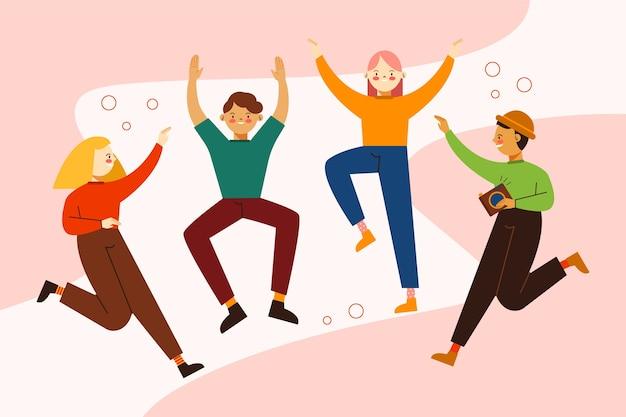 Szczęśliwi młodzi ludzie skaczący