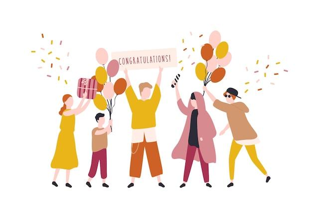 Szczęśliwi młodzi mężczyźni i kobieta obchodzi urodziny. ludzie radujący się z przyjęcia niespodzianki