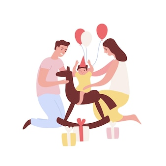 Szczęśliwi młodzi rodzice trzymający synka na koniu na biegunach świętujący urodziny