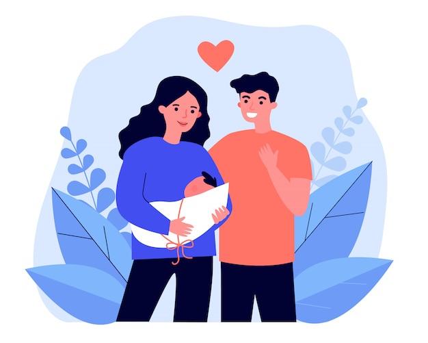 Szczęśliwi nowi rodzice trzymając dziecko
