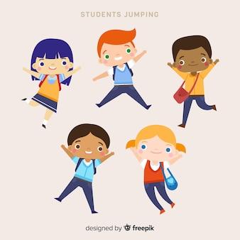 Szczęśliwi ręka rysujący uczni skakać