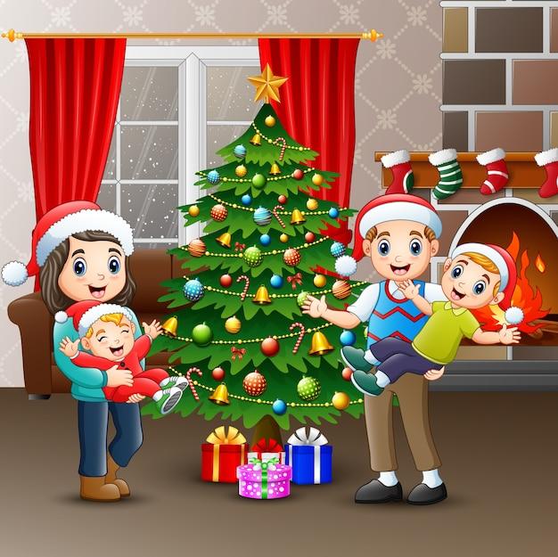 Szczęśliwi rodzinni świętuje boże narodzenia przy domem
