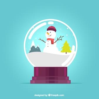 Szczęśliwy bałwan wewnątrz kuli śniegu
