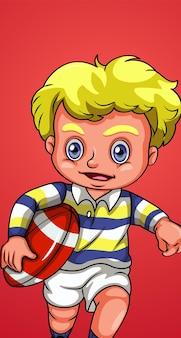 Szczęśliwy chłopiec grający w rugby