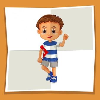 Szczęśliwy chłopiec macha ręką