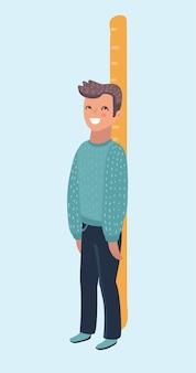 Szczęśliwy chłopiec mierzy swój wzrost dużą linijką i stoi