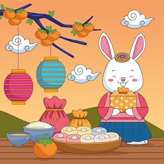 Szczęśliwy chuseok celebracja z królikiem podnoszącym prezent i jedzenie