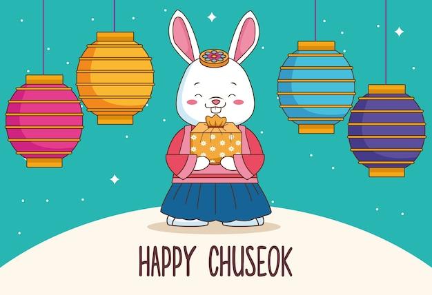 Szczęśliwy chuseok z prezentem podnoszącym królika i wiszącymi lampami