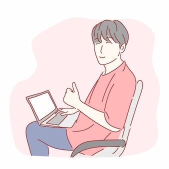 Szczęśliwy człowiek gestykuluje kciuki przed laptopem w wyciągnąć rękę