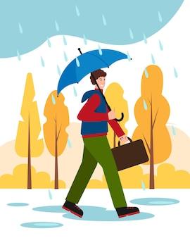 Szczęśliwy człowiek z parasolem w parku idzie do pracy jesienna pogoda deszczowa