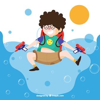 Szczęśliwy dzieciak bawić się z wodnymi pistoletami
