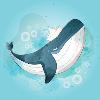 Szczęśliwy dziecko wieloryb jest ubranym papierowego statku kapelusz