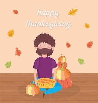Szczęśliwy dzień dziękczynienia człowiek siedzący z dyni i ciasto