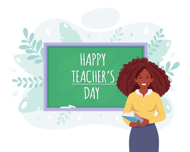 Szczęśliwy dzień nauczyciela afroamerykanka nauczycielka w klasie