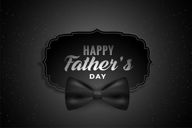 Szczęśliwy dzień ojca czarne tło z realistyczną kokardą