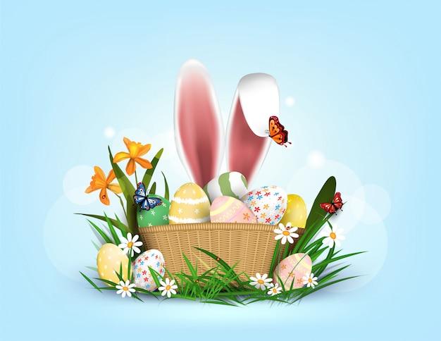 Szczęśliwy element wielkanocny dla projektu. jajka w zielonej trawie z białymi kwiatami na białym tle