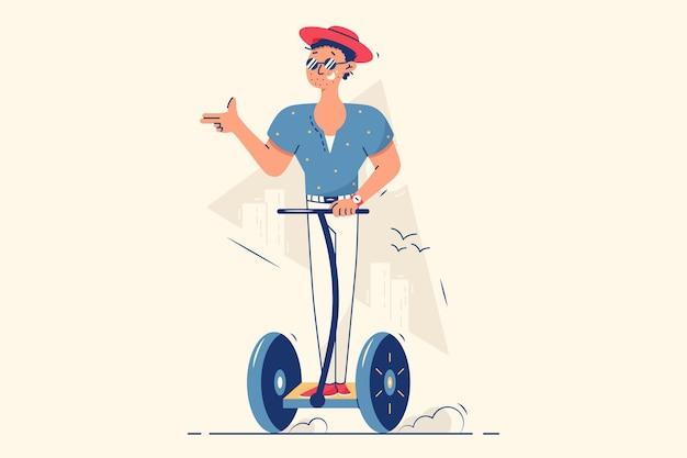 Szczęśliwy facet jedzie skuterem elektrycznym na ulicy