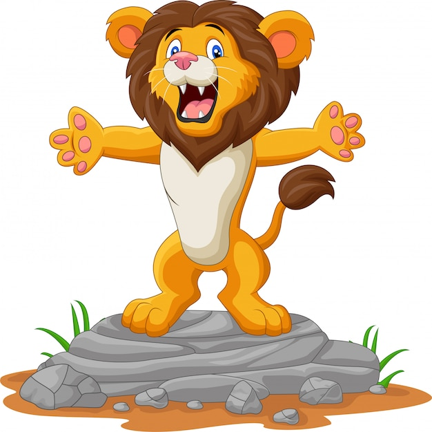 Szczęśliwy kreskówka lew pozuje na skale
