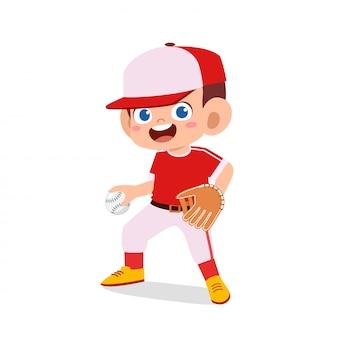 Szczęśliwy ładny dzieciak chłopiec grać w baseball