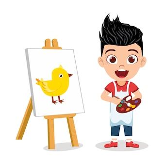 Szczęśliwy ładny dzieciak chłopiec rysuje piękny obraz piskląt z wesołym wyrazem