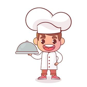 Szczęśliwy ładny kucharz chłopiec na białym tle