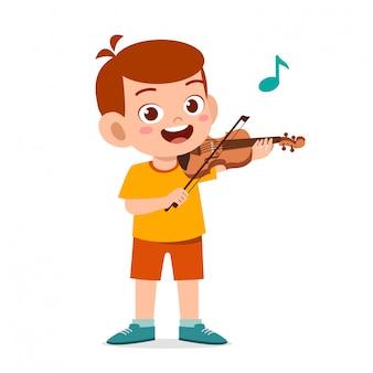szczęśliwy ładny małe dziecko chłopiec grać na skrzypcach