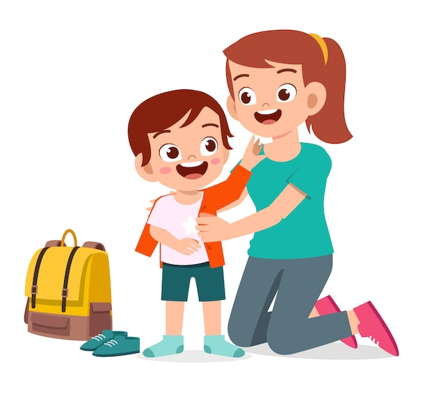 Szczęśliwy ładny małe dziecko chłopiec przygotowuje się do szkoły z mamą