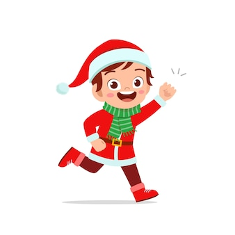 Szczęśliwy ładny mały chłopiec i dziewczynka na sobie czerwony świąteczny kostium