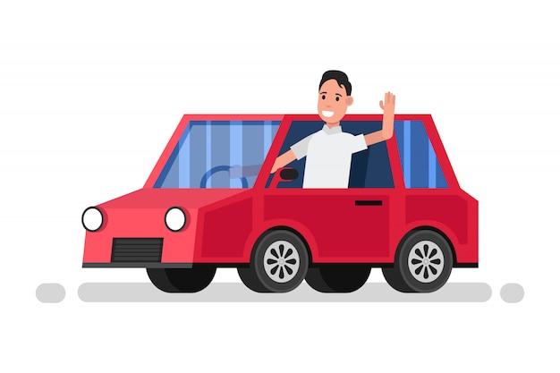 Szczęśliwy mężczyzna jedzie w czerwonym samochodzie