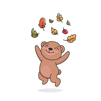 Szczęśliwy miś rzuca jesienne liście