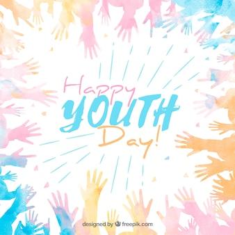 Szczęśliwy młodość dnia tło z akwareli kolorowymi rękami